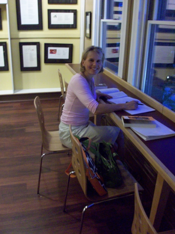 Myers sits at a coffee shop working on an assignment for the writers' workshop. Photo courtesy of Katherine Myers.